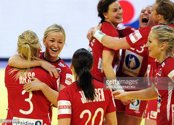 Norway's players celebrate their victory over Hungary during the 2012 EHF European Women's Handball Championship semifinal match on December 15 2012...