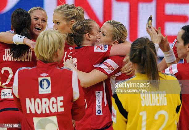 Norway's players celebrate their victory over Hungary during the 2012 EHF European Women's Handball Championship semifinal match on December 15 at...
