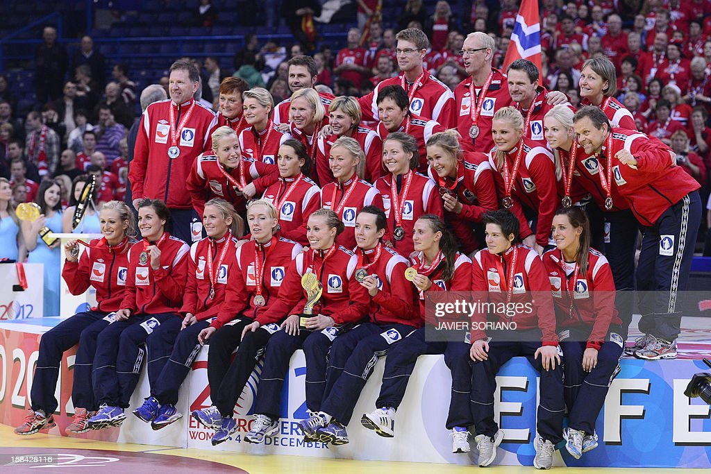 Norway's players pose on the podium after taking the second place during the Women's EHF Euro 2012 Handball Championship final on December 16, 2012, at the Kombank Arena in Belgrade.