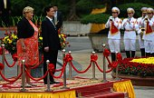 Norway's Prime Minister Erna Solberg and her Vietnamese counterpart Nguyen Tan Dung listen to national anthems on a podium during a welcoming...
