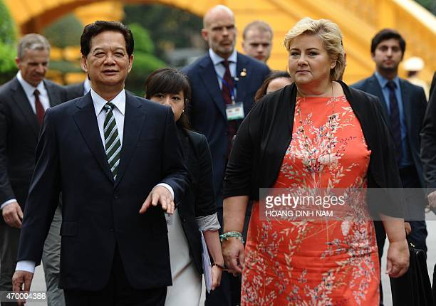 Norway's Prime Minister Erna Solberg and her Vietnamese counterpart Nguyen Tan Dung walk toward Dung's Cabinet Office for official talks at the...
