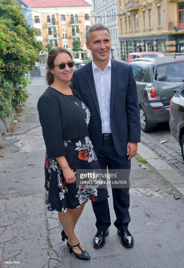 Norway's Prime Minister Jens Stoltenberg (R) and his wife Ingrid Schulerud pose for photographers on their way to a polling station in Oslo, on September 8, 2013. Norway's centre-right opposition looks set to oust Prime Minister Jens Stoltenberg in Monday's general election, paving the way for an anti-immigration party to enter government two years after right-wing extremist Anders Behring Breivik's deadly attacks. AFP PHOTO / DANIEL SANNUM LAUTEN