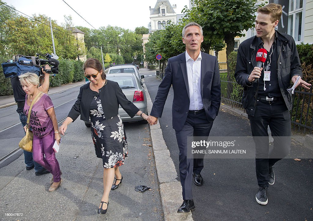 Norway's Prime Minister Jens Stoltenberg (2ndR) and his wife Ingrid Schulerud (3rd R) talk to media on their way to a polling station in Oslo, on September 8, 2013. Norway's centre-right opposition looks set to oust Prime Minister Jens Stoltenberg in Monday's general election, paving the way for an anti-immigration party to enter government two years after right-wing extremist Anders Behring Breivik's deadly attacks.