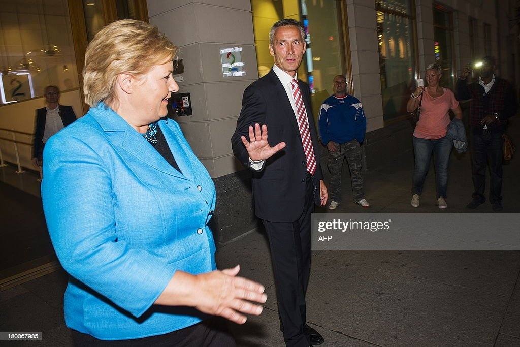 Norway's Prime Minister Jens Stoltenberg (R) and main opposition leader Erna Solberg leave a TV station after a TV show in Oslo, on September 8, 2013. Norway holds general elections on September 8 and 9, 2013. AFP PHOTO / VARFJELL, FREDRIK NORWAY OUT
