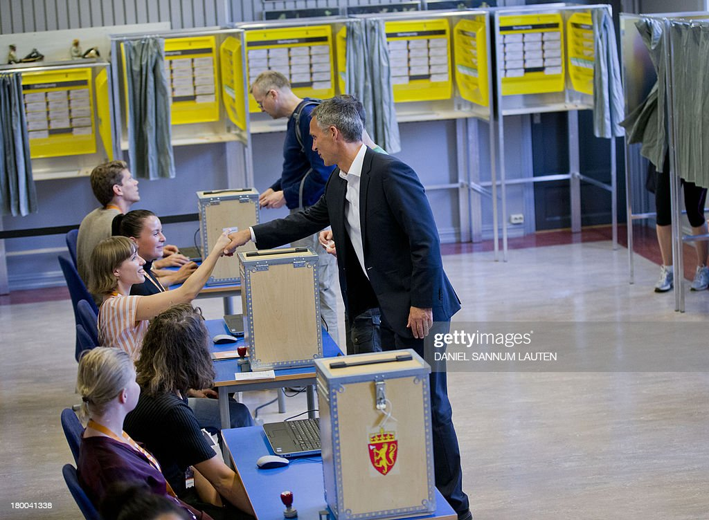 Norway's Prime Minister Jens Stoltenberg (R) greets helpers as he makes his vote in the parliamentary election at a polling station in Oslo, on September 8, 2013. Norway's centre-right opposition looks set to oust Prime Minister Jens Stoltenberg in Monday's general election, paving the way for an anti-immigration party to enter government two years after right-wing extremist Anders Behring Breivik's deadly attacks. AFP PHOTO / DANIEL SANNUM LAUTEN