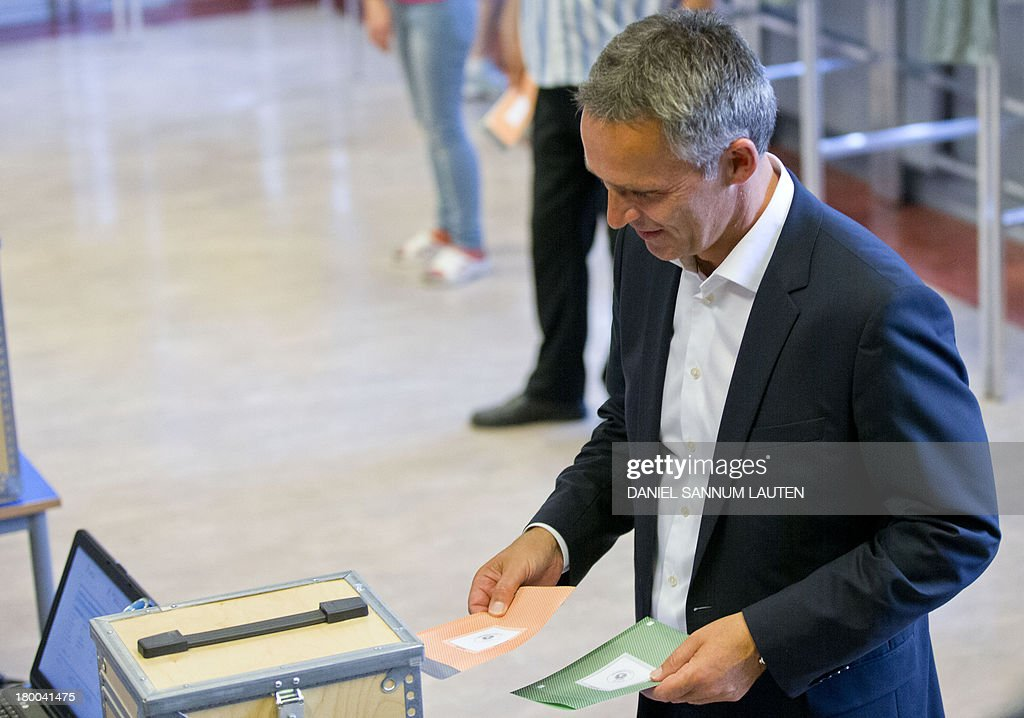 Norway's Prime Minister Jens Stoltenberg holds his ballots to make a vote in the parliamentary election at a polling station in Oslo, on September 8, 2013. Norway's centre-right opposition looks set to oust Prime Minister Jens Stoltenberg in Monday's general election, paving the way for an anti-immigration party to enter government two years after right-wing extremist Anders Behring Breivik's deadly attacks. AFP PHOTO / DANIEL SANNUM LAUTEN