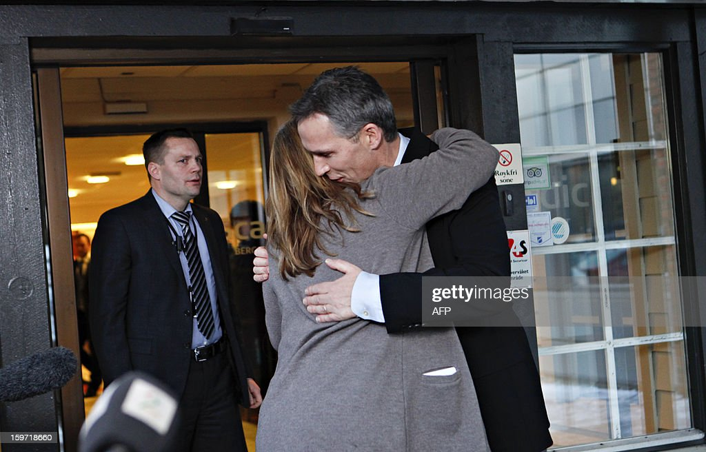 Norway's Prime Minister Jens Stoltenberg (R) is embraced by Statoil's Executive Vice President Margrethe Oevrum during a press conference on Januaray 19, 2013, after his visit at the drop-in center in Bergen, Norway for relatives of the Statoil-employees taken hostages in Algeria. Two Norwegians have been found alive but six others remain unaccounted for in the hostage crisis at a gas field in Algeria, Norway's Statoil said Saturday. AFP PHOTO / ANETTE KARLSEN, SCANPIX NORWAY / NORWAY OUT