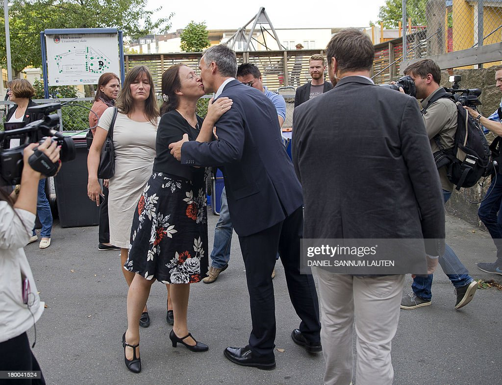 Norway's Prime Minister Jens Stoltenberg (C) kisses his wife Ingrid Schulerud as they leave a polling station in Oslo, on September 8, 2013. Norway's centre-right opposition looks set to oust Prime Minister Jens Stoltenberg in Monday's general election, paving the way for an anti-immigration party to enter government two years after right-wing extremist Anders Behring Breivik's deadly attacks.