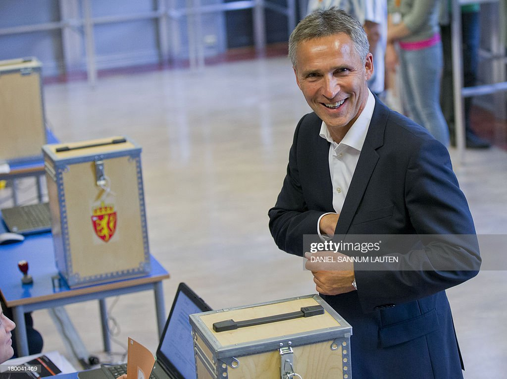 Norway's Prime Minister Jens Stoltenberg smiles after casting his ballot in the parliamentary election at a polling station in Oslo, on September 8, 2013