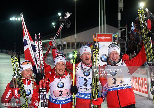 Norway's relay biathletes Tiril Eckhoff Fanny WelleStrand Horn Tarjei Boe and Johannes Thingnes Boe celebrate winning the Mixed 2x6 plus 2x75 Km...