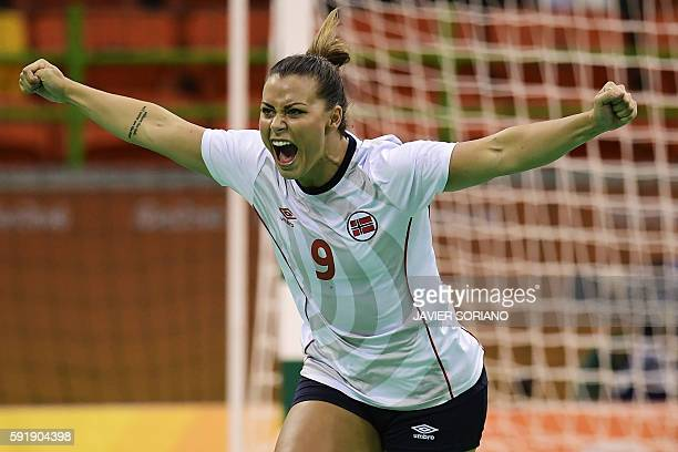 TOPSHOT Norway's right back Nora Mork celebrates a goal during the women's semifinal handball match Norway vs Russia for the Rio 2016 Olympics Games...
