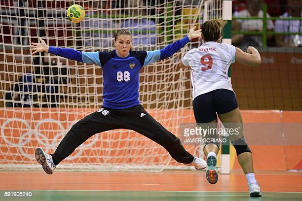 Norway's right back Nora Mork shoots at Russia's goalkeeper Viktoriia Kalinina during the women's semifinal handball match Norway vs Russia for the...