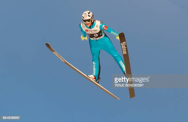Norway´s Robert Johansson soars before landing on 252 meters new world record during FIS Ski Jumping World Cup Men´s Team HS225 in Vikersund on March...