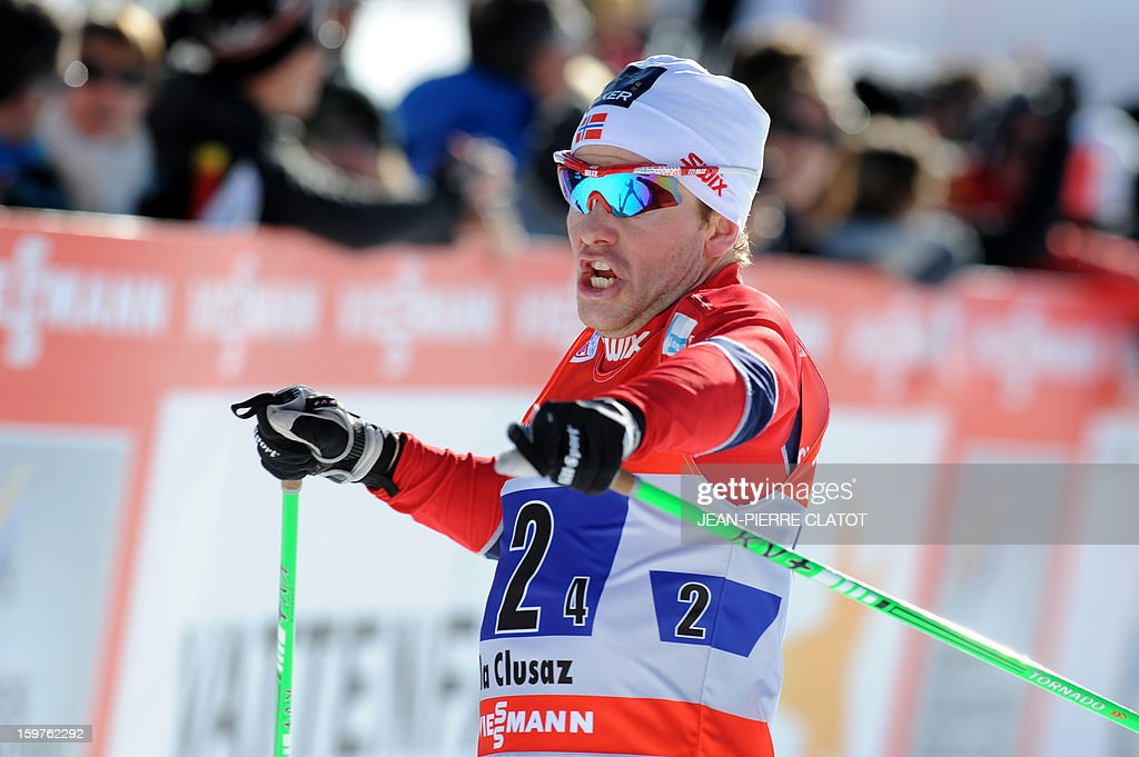 Norway's Sjur Roethe celebrates his victory as he crosses the finish line of the Nordic skiing combined World Cup relay (4 x 7,5 km) on January 20, 2013 in La Clusaz, eastern France. AFP PHOTO JEAN-PIERRE CLATOT