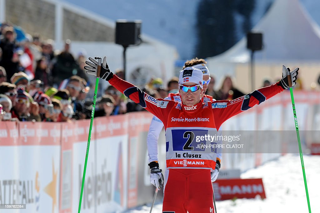 Norway's Sjur Roethe raises his arms in victory as he crosses the finish line of the Nordic skiing combined World Cup relay (4 x 7,5 km) on January 20, 2013 in La Clusaz, eastern France.