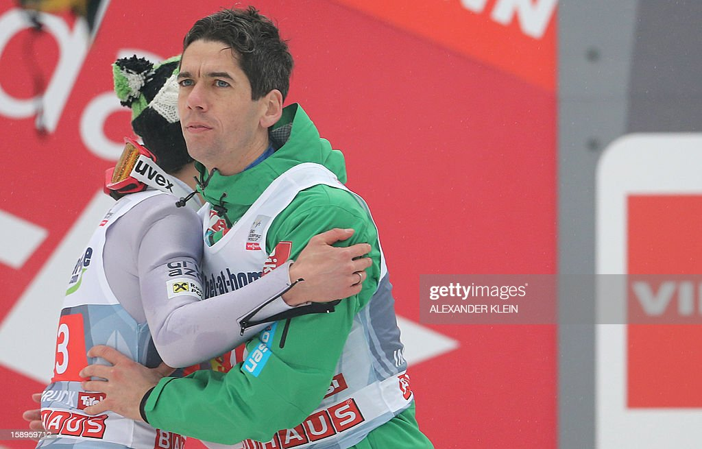 Norway's ski jumper Anders Bardal (R) embraces Poland's Kamil Stoch (L) after the 61st Four Hills tournament in Innsbruck, Austria on January 4, 2013. Austria's Schlierenzauer won ahead of Poland's Kamil Stoch and Norway's Anders Bardal.