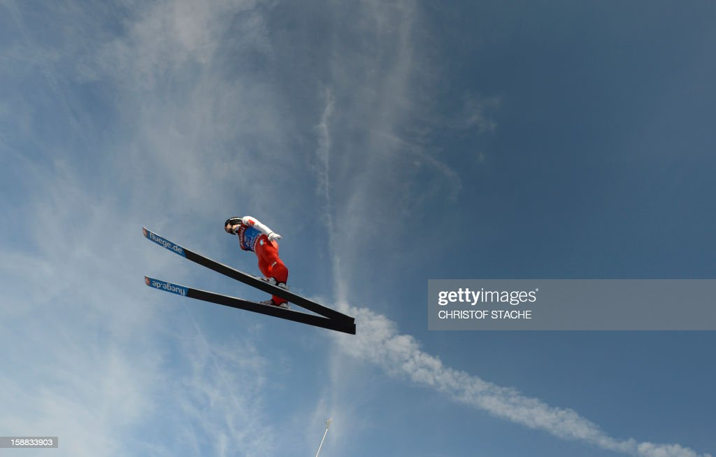 Norway's ski jumper Anders Jacobsen soars through the air during his trial jump at the 61th edition of the Four-Hills-Tournament (Vierschanzentournee) on December 31, 2012 in Garmisch-Partenkirchen, southern Germany. The second competition of the jumping event will take place in Garmisch-Partenkirchen, before the tournament continues in Innsbruck (Austria) and in Bischofshofen (Austria).