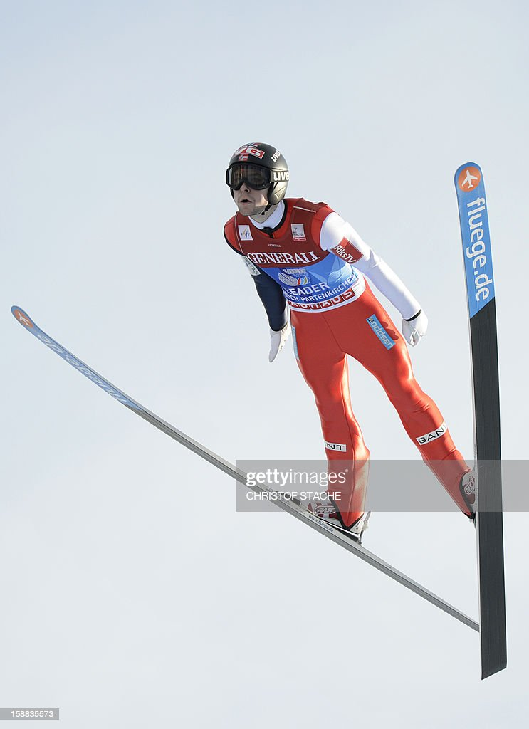 Norway's ski jumper Anders Jacobsen soars through the air during his trial jump at the 61th edition of the Four-Hills-Tournament (Vierschanzentournee) on December 31, 2012 in Garmisch-Partenkirchen, southern Germany. The second competition of the jumping event will take place in Garmisch-Partenkirchen, before the tournament continues in Innsbruck (Austria) and in Bischofshofen (Austria). AFP PHOTO/CHRISTOF STACHE