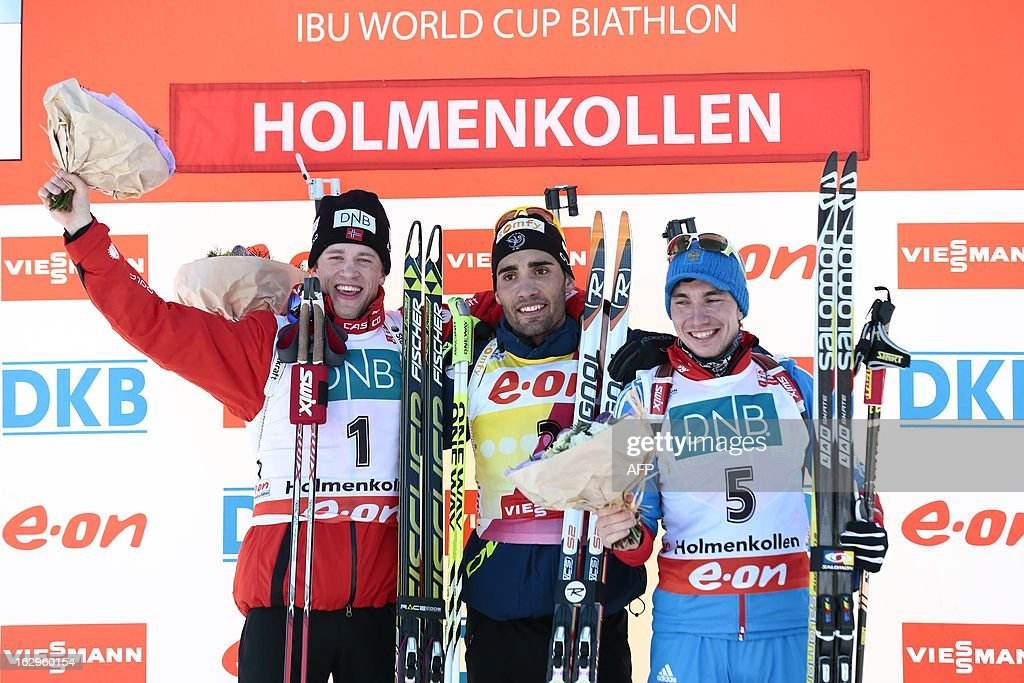 Norway`s Tarjei Boe second placed, France's winner Martin Fourcade and Russia's Alexandr Loginov third placed pose for photographers after the men's 12,5 km pursuit race at the Biathlon World Cup in Oslo on March 2, 2013.