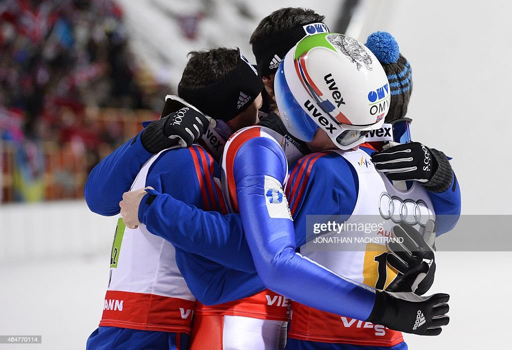 Norway's team (L to R) <a gi-track='captionPersonalityLinkClicked' href=/galleries/search?phrase=Anders+Jacobsen+-+Ski+Jumper&family=editorial&specificpeople=12186216 ng-click='$event.stopPropagation()'>Anders Jacobsen</a>, <a gi-track='captionPersonalityLinkClicked' href=/galleries/search?phrase=Anders+Bardal&family=editorial&specificpeople=2146620 ng-click='$event.stopPropagation()'>Anders Bardal</a> (covered), <a gi-track='captionPersonalityLinkClicked' href=/galleries/search?phrase=Rune+Velta&family=editorial&specificpeople=6845746 ng-click='$event.stopPropagation()'>Rune Velta</a> and Anders Fannemel celebrate after competing at the Men Large Hill Team competition of the 2015 FIS Nordic World Ski Championships in Falun, Sweden, on February 28, 2015. Norway's team won ahead of Austria and Poland. AFP PHOTO / JONATHAN NACKSTRAND
