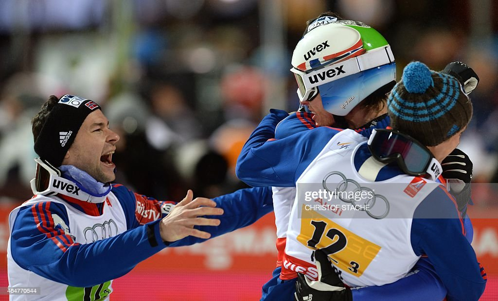 Norway's team (L to R) <a gi-track='captionPersonalityLinkClicked' href=/galleries/search?phrase=Anders+Jacobsen+-+Ski+Jumper&family=editorial&specificpeople=12186216 ng-click='$event.stopPropagation()'>Anders Jacobsen</a>, <a gi-track='captionPersonalityLinkClicked' href=/galleries/search?phrase=Rune+Velta&family=editorial&specificpeople=6845746 ng-click='$event.stopPropagation()'>Rune Velta</a>, Anders Fannemel and <a gi-track='captionPersonalityLinkClicked' href=/galleries/search?phrase=Anders+Bardal&family=editorial&specificpeople=2146620 ng-click='$event.stopPropagation()'>Anders Bardal</a> (covered) celebrate after competing at the Men Large Hill Team competition of the 2015 FIS Nordic World Ski Championships in Falun, Sweden, on February 28, 2015. Norway's team won ahead of Austria and Poland. AFP PHOTO / CHRISTOF STACHE