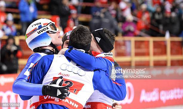 Norway's team Rune Velta Anders Bardal Anders Jacobsen and Anders Fannemel celebrate after competing at the Men Large Hill Team competition of the...