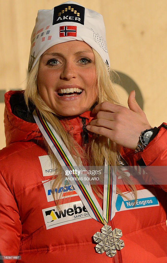 Norway's Therese Johaug poses with her Bronze Medal on the podium at the medals ceremony of the Women's Cross Country 30 km Classic race of the FIS Nordic World Ski Championships at Val Di Fiemme Cross Country stadium in Cavalese, northern Italy, on March 2, 2013. AFP PHOTO / ANDREAS SOLARO