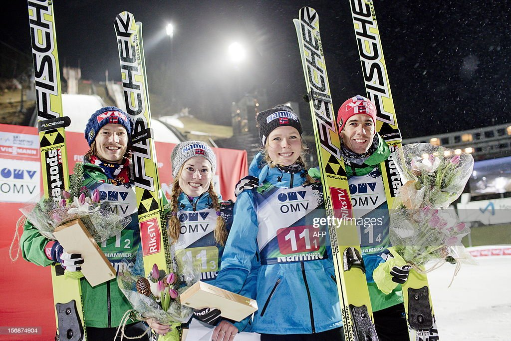 Norway`s Tom Hilde, Anette Sagen, Maren Lundby and Anders Bardal celebrate after winning the FIS Ski jumping World Cup Normal Hill Mixed Team competition in Lillehammer on November 23, 2012.