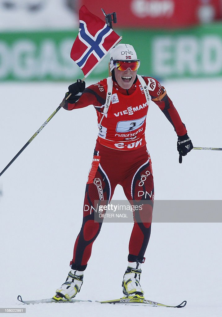 Norway´s Tora Berger crosses the finish line and wins the 4x6 km relay event at the IBU World Cup on December 9, 2012 in Hochfilzen, Austrian Alps.