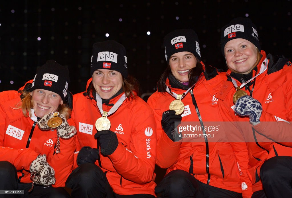 Norway's (L to R) Tora Berger,Synnoeve Solemdal, Ann Kristin Aafedt Flatland and Hilde Fenne present their gold medals for the women 4x6 Km relay as part of IBU Biathlon World Championships in Nove Mesto, Czech Republic, on February 16, 2013.