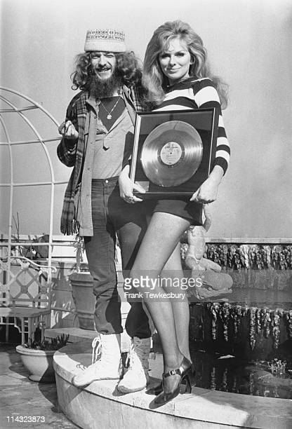 Norwegian actress Julie Ege awards a gold disc to Jethro Tull singer and flautist Ian Anderson on the roof of the Dorchester Hotel London 19th...