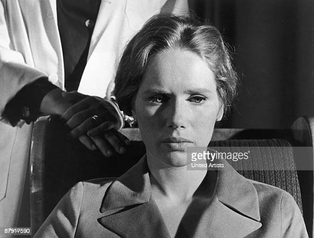 Norwegian actress writer and director Liv Ullmann sits in a chair while an unseen woman wearing a white lab coat stands behind her in a still from...