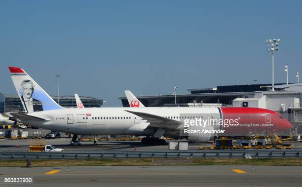 Norwegian Air Shuttle passenger jet parked at a gate at John F Kennedy International Airport in New York New York features a portrait of Danish...