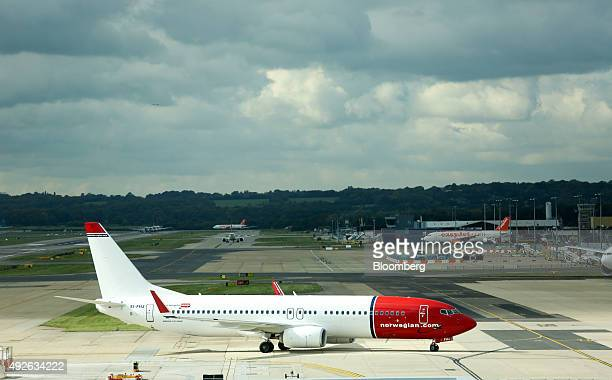 A Norwegian aircraft operated by Norwegian Air Shuttle ASA taxis along the tarmac at London Gatwick Airport in London UK on Wednesday Oct 14 2015...