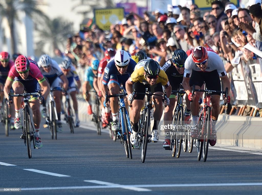 Norwegian Alexander Kristoff (R) of Team Katusha and Britain's Mark Cavendish (C) of Dimension Data team sprint on the finish line of the 5th and final stage of the 15th Tour of Qatar on February 12, 2016, in Qatar. Alexander Kristoff won the 5th stage, while Mark Cavendish won the overall gold jersey. / AFP / Eric FEFERBERG