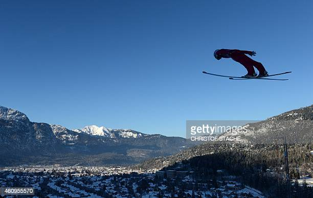 Norwegian Anders Jacobsen soars induring his first competition jump for the second session of the FourHills Ski jumping tournament in...