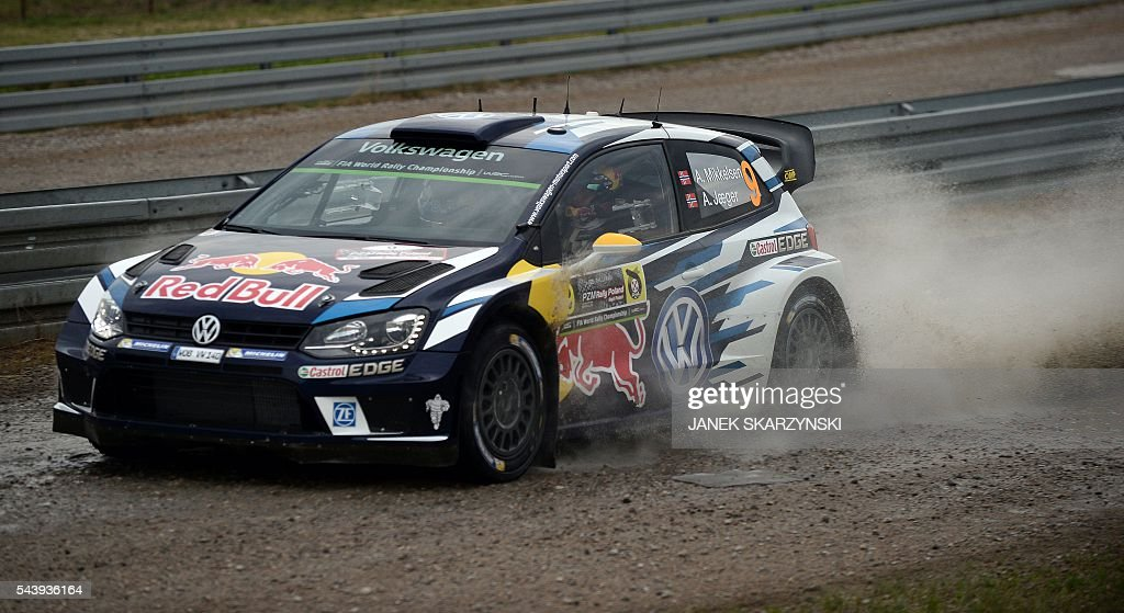 Norwegian Andreas Mikkelsen and Norwegian co-driver Anders Synnevaag, steer their Volkswagen Polo R WRC during the Rally of Poland on June 30, 2016 in Mikolajki, north of Poland. / AFP / JANEK