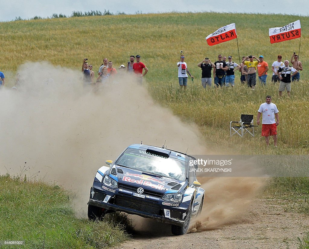 Norwegian Andreas Mikkelsen and Norwegian co-driver Anders Synnevaag drive their Volkswagen Polo R WRC during the special stage of The Rally of Poland in Stare Juchy, north of Poland on July 1, 2016. / AFP / JANEK
