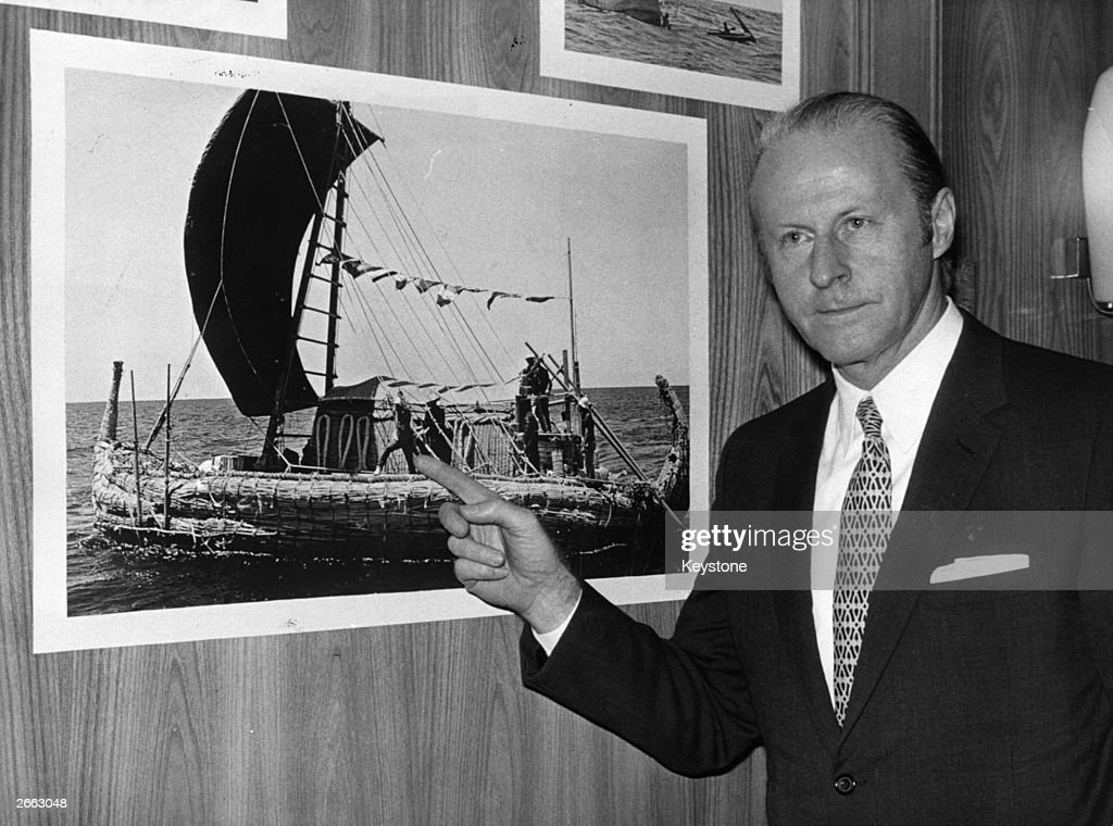 Norwegian anthropologist <a gi-track='captionPersonalityLinkClicked' href=/galleries/search?phrase=Thor+Heyerdahl&family=editorial&specificpeople=931459 ng-click='$event.stopPropagation()'>Thor Heyerdahl</a> (1914 - 2002) pointing to a picture of himself on board the papyrus-reed raft which he used on his 'Ra Expeditions' to test the theory that ancient Mediterranean people crossed the Atlantic before Columbus.