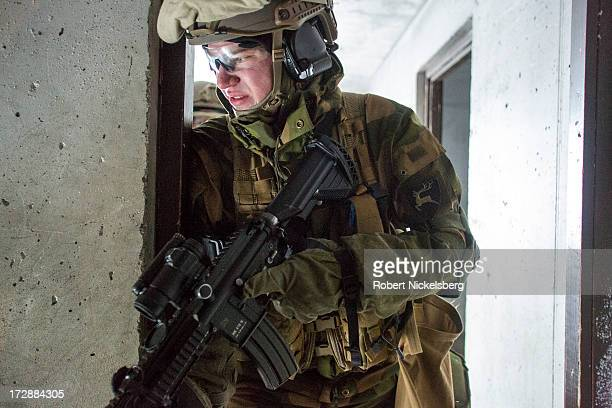 Norwegian army soldiers practice attacking a remote Arctic outpost March 7 2013 in kneedeep snow in Skjold Norway Urban warfare is equally...