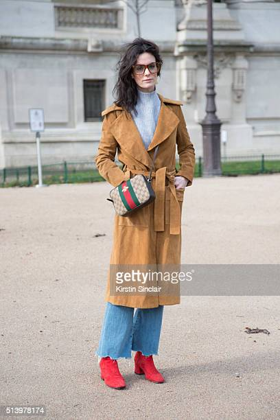 Norwegian Blogger Hedvig Sagfjord Opshaug wears a Gucci bag and glasses Mih jeans and Doroteymur boots on day 5 during Paris Fashion Week...
