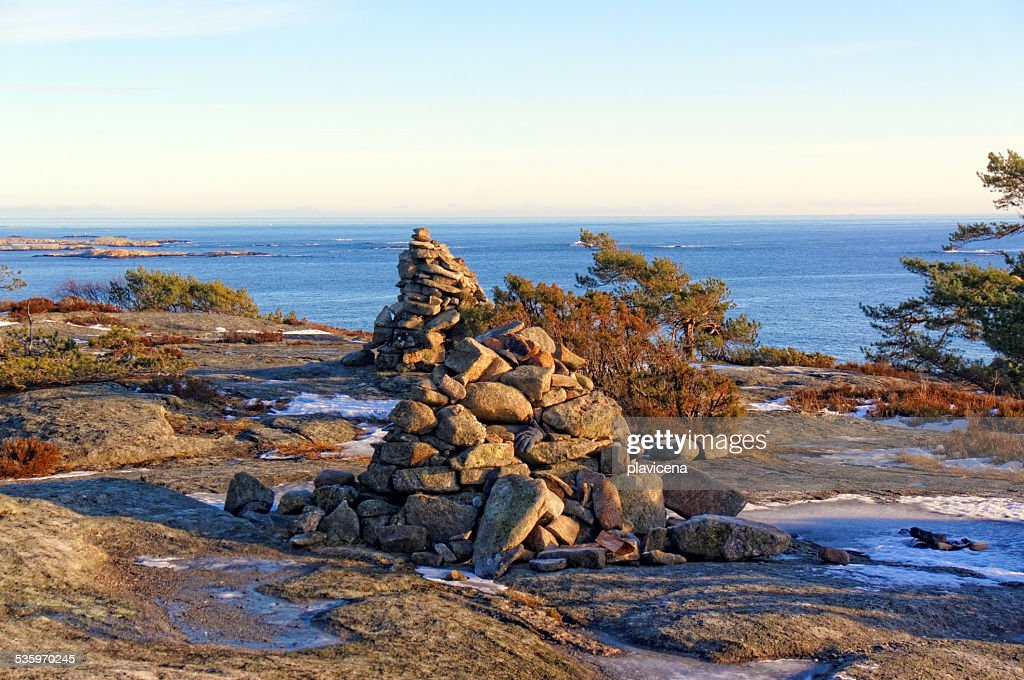 Norwegian cairn a man-made pile or stack of stones : Stock Photo