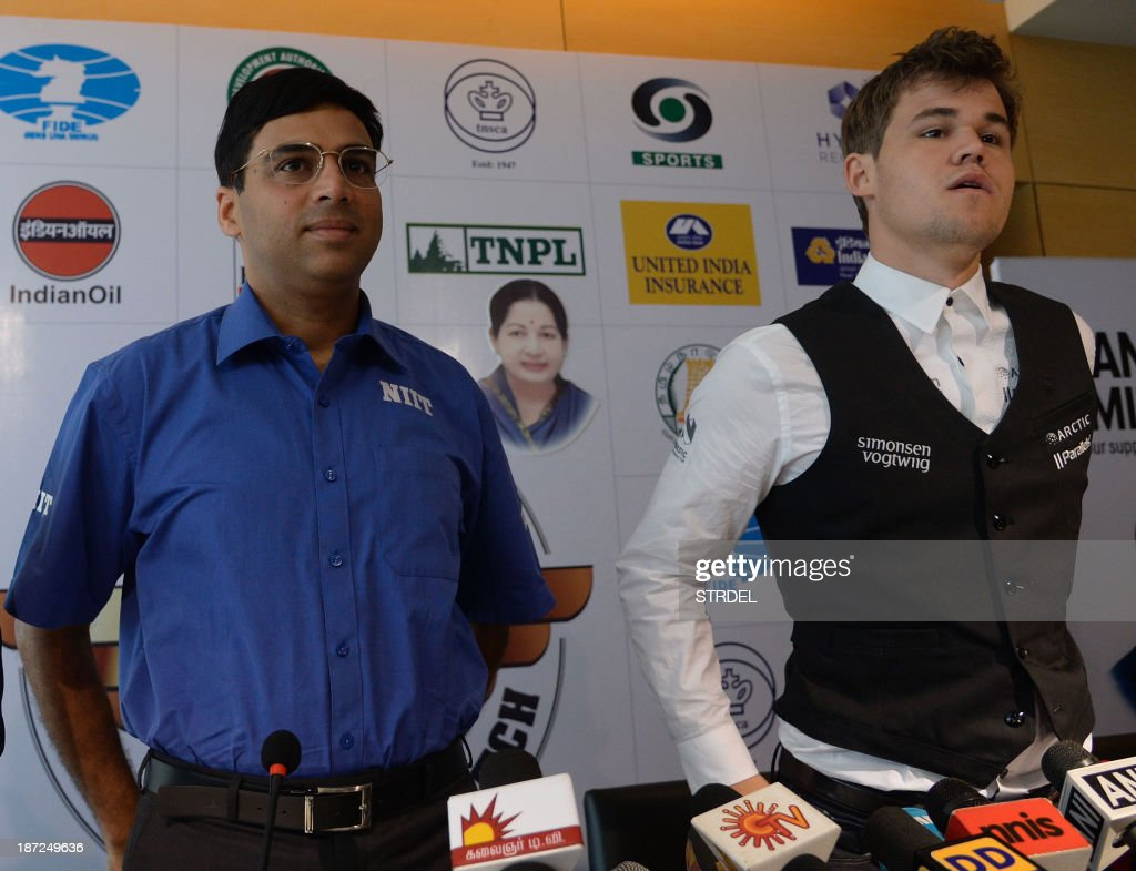 Norwegian chess player Magnus Carlsen (R) and Indian world chess champion Viswanathan Anand answer media representatives questions at a press conference in Chennai on November 7, 2013, ahead of the world chess championship in the southern Indian city. Reigning world chess champion Viswanathan Anand finds himself relegated to the role of underdog as he prepares to defend his crown against Norwegian sensation Magnus Carlsen at home in Chennai from November 9.