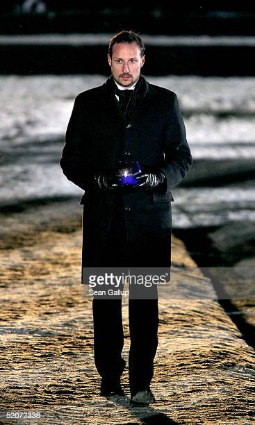 Norwegian Crown Prince Haakon carries a candle at the main memorial during ceremonies marking the 60th anniversary of the liberation of the Auschwitz...