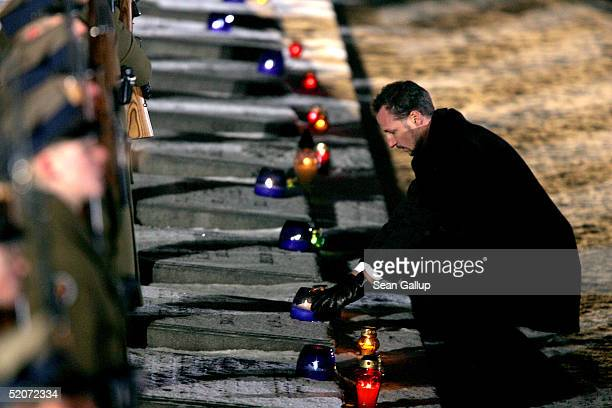 Norwegian Crown Prince Haakon lays a candle at the main memorial during ceremonies marking the 60th anniversary of the liberation of the Auschwitz...