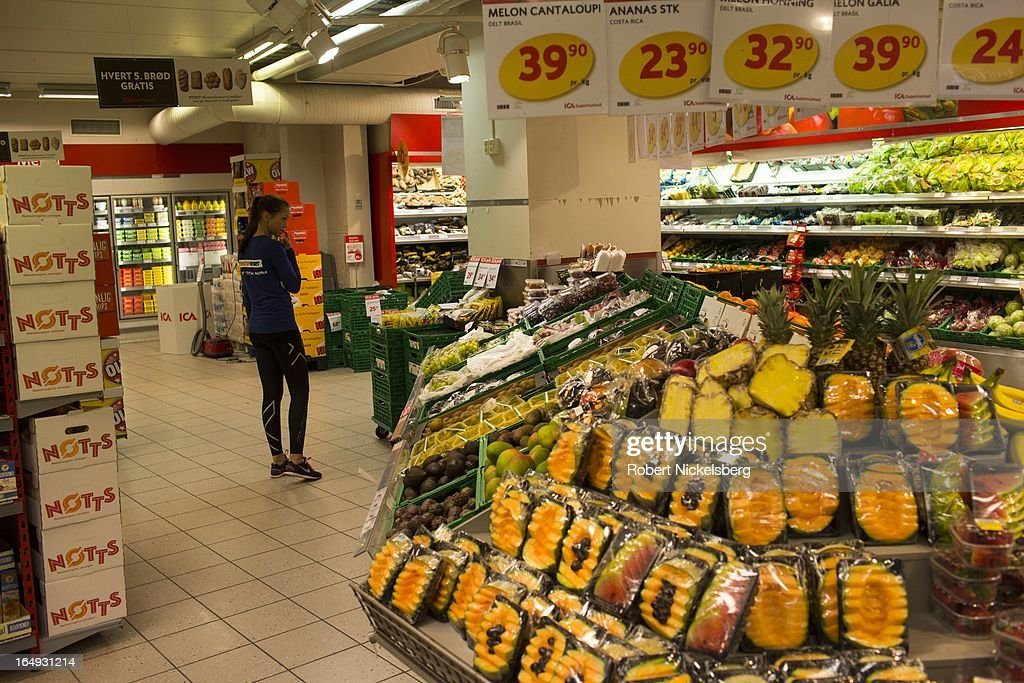 A Norwegian customer looks at fruit display at a supermarket February 28, 2013 in Bodo, Norway. Norway has one of the highest price levels for personal goods and services in all of Europe. The cost of food is 47% higher than the continental European average.