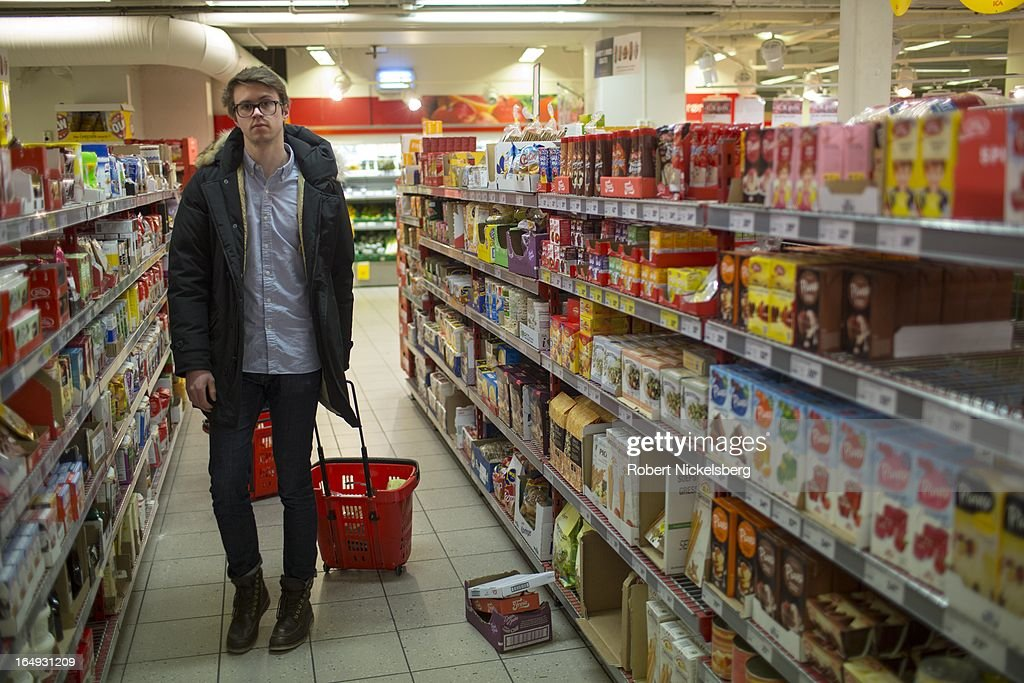A Norwegian customer shops at a supermarket February 28, 2013 in Bodo, Norway. Norway has one of the highest price levels for personal goods and services in all of Europe. The cost of food is 47% higher than the continental European average.
