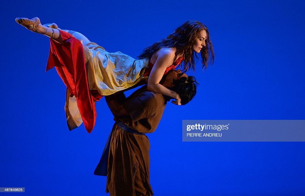 Norwegian dancer Ella Fiskum (Top) and Indian dancer Sudesh Adhana perform during a full dress rehearsal of the Opera 'A Flowering Tree' at the Chatelet theater on May 2, 2014 in Paris. The Opera by composer John Adams and staged by Indian director and screenwriter Vishal Bhardwaj, is inspired by a southern Indian folk tale describing the trials and tribulations of a young couple to demonstrate the power of love. It shows through May 5 - 13, 2014 at the Chatelet theater in Paris.