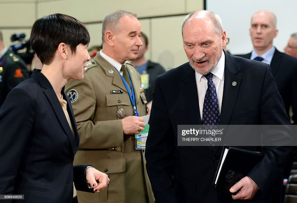 Norwegian Defence Minister Ine Marie Eriksen Soreide (L) and Polish Defence Minister Antoni Macierewicz (R) arrive prior to a meeting of the North Atlantic Council (NAC) of Defence Ministers at the NATO headquarters in Brussels, February 10, 2016. NATO defence ministers convene a two-day meeting to discuss current defense issues and whether the Alliance should take a more direct role in dealing with its gravest migrant crisis since Worl War II. / AFP / THIERRY CHARLIER
