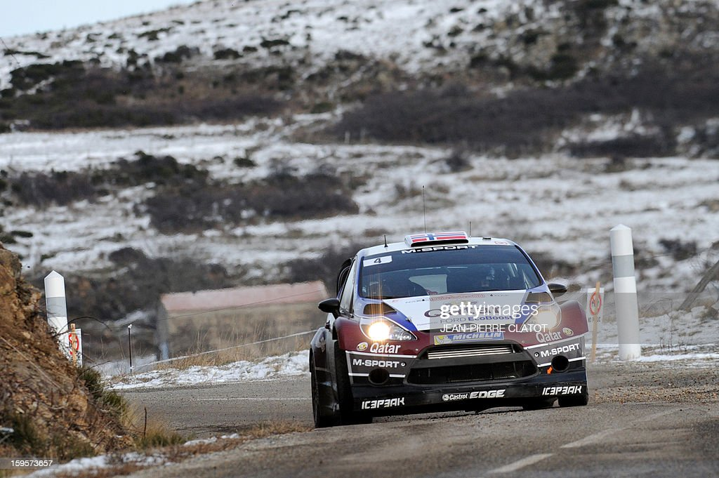 Norwegian driver Mads Ostberg steers his Ford Fiesta RS on January 16, 2013 at the Col de la Fayolle, southeastern France, during the third stage of the 81st Monte-Carlo Rallye between Le Moulinon and Antraigues. AFP PHOTO / Jean Pierre Clatot